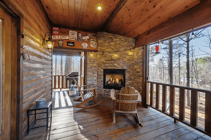 Wraparound porch with fireplace and hot tub