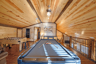game room with billiards pool video games and movie screen